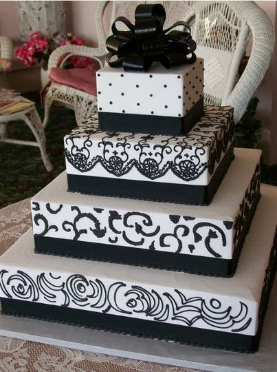 4-tier square wedding cake with black detailing