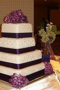 Wedding cake with violet ribbons