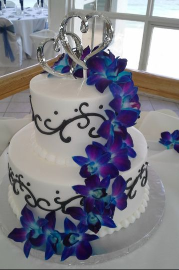 2-tier cake with electric blue orchids