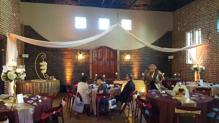 Reception in a French Farm House.  Light draping and lighting to compliment not hide the natural...
