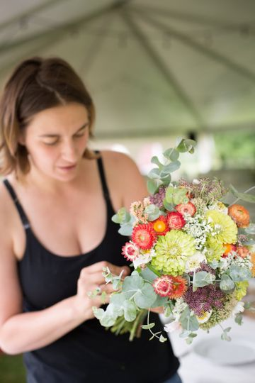 Maya working on a bridal bouquet on-site in july - 100% hillen homestead flowers. Photo by jamie...