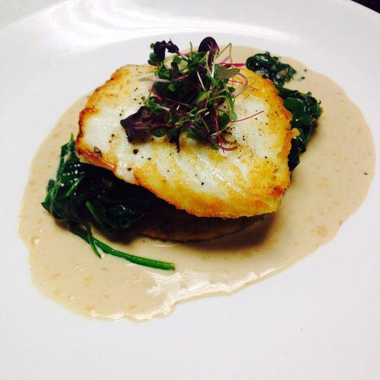 Pan seared striped bass with wild mushroom ragout, sautéed rainbow swiss chard and roasted pepper...