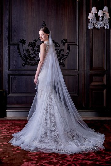 Monique Lhuillier L'Amour a  lace sheath gown with illusion low back and tulle overskirt