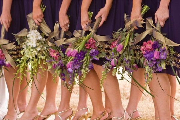 an accent on the maid of honor with her white dendrobium orchids compliments the bridesmaids tulips,...