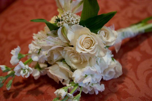 Simple white florals for the Mothers of the Bride and Groom