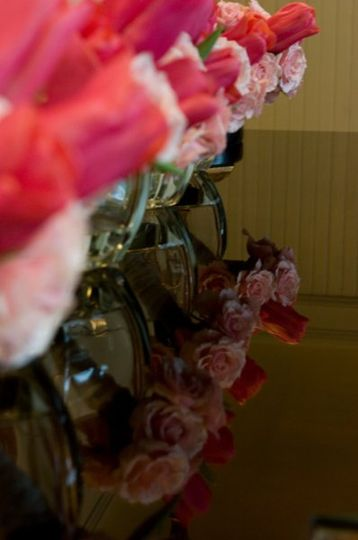 Delicate clutch bouquets wait in the foyer of the church as guests arrive offering a hint of what is...