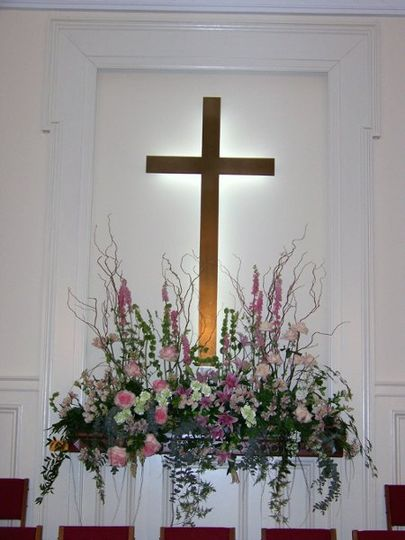 A spring garden event enhanced with a window box design at the altar
