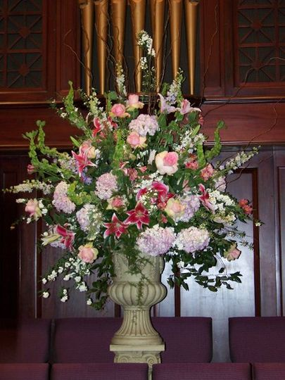Lavender hydrangea, stargazers, roses and larkspur establish the massive scale  foreground for the...