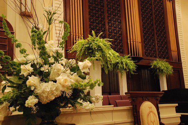 the elegance of the pipe organ overlooks the ceremony of white garden florals