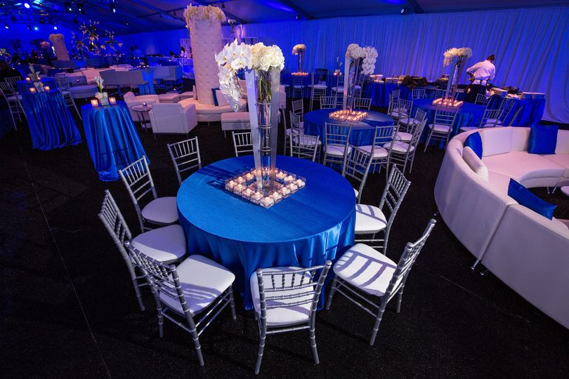 Our Silver Chiavari Chairs with White Pads.
