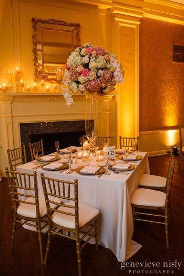 Our Gold Chiavari Chairs with White Pads.