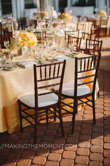 Our Mahogany Chiavari Chairs with White Pads.
