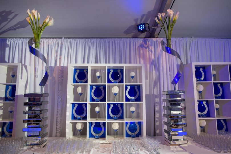 Back Bar display made from our White Cube Units and Mirrored Step Pedestals. We filled the cubes...