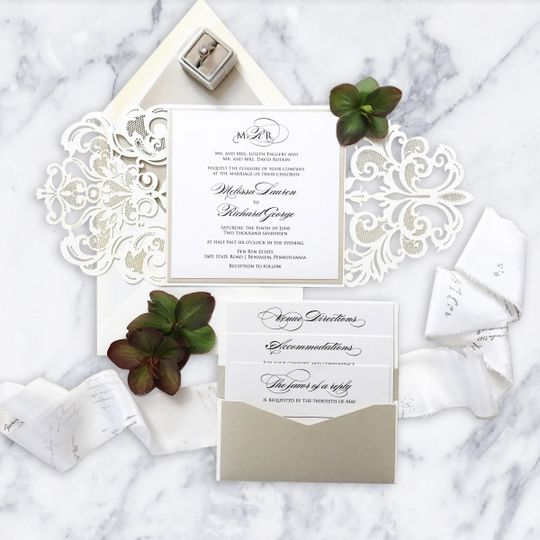 White invitation with intricate carvings