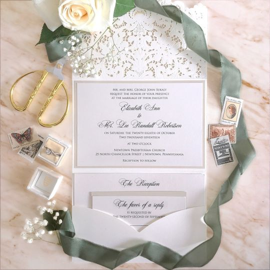 Wedding invitation decorated with baby's breath flowers