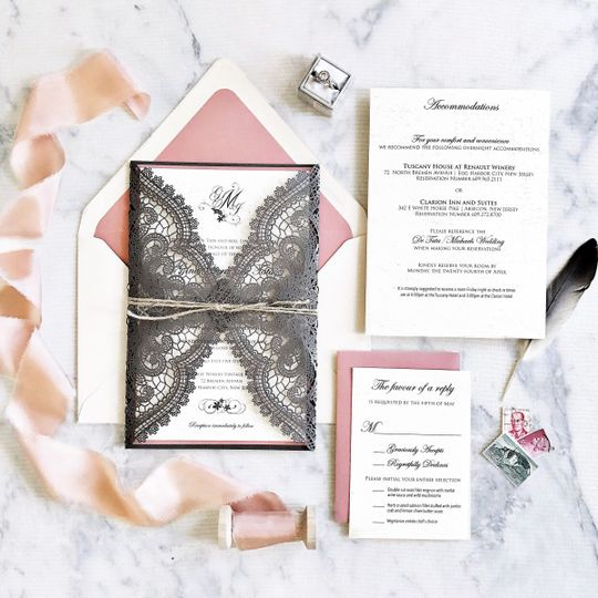 Black lace invitation with pink lining in envelope