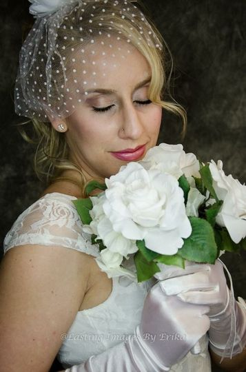 Bride with gloves and birdcage veil