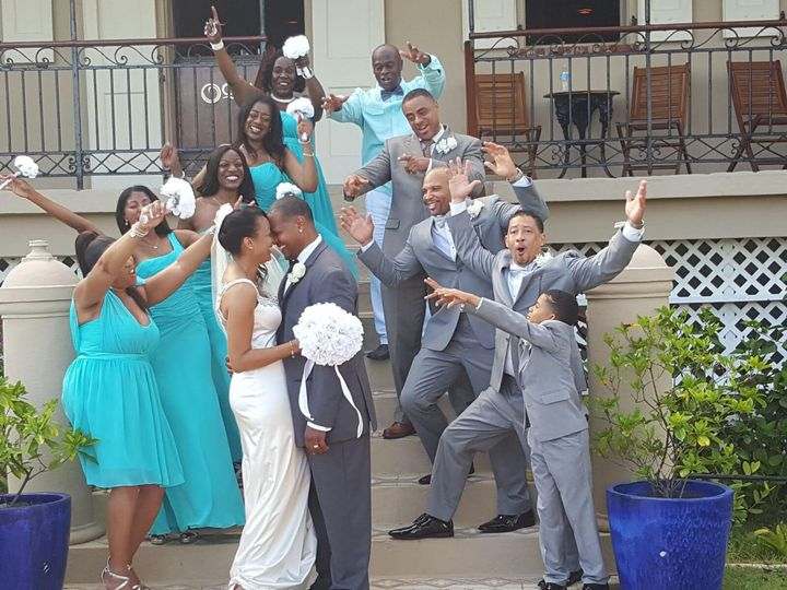 Bride and Groom is cheered on by the family and friends for their destination Wedding