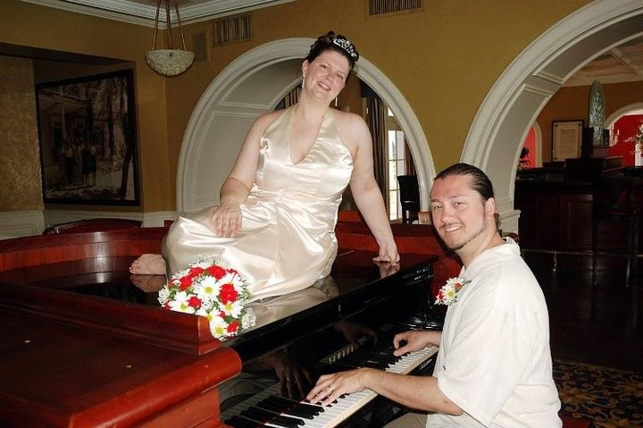 Bride on the piano while groom plays