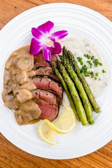 Steak with mushroom sauce and sides