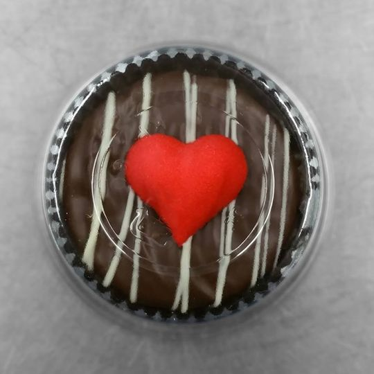 This favor features a cookie covered in our special house blend of premium milk and dark chocolate...