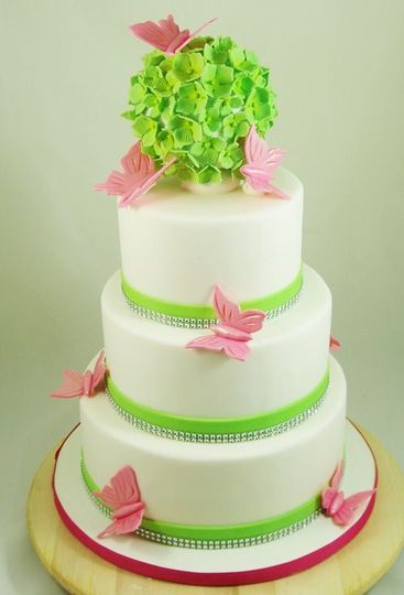 Wedding cake with green ribbon
