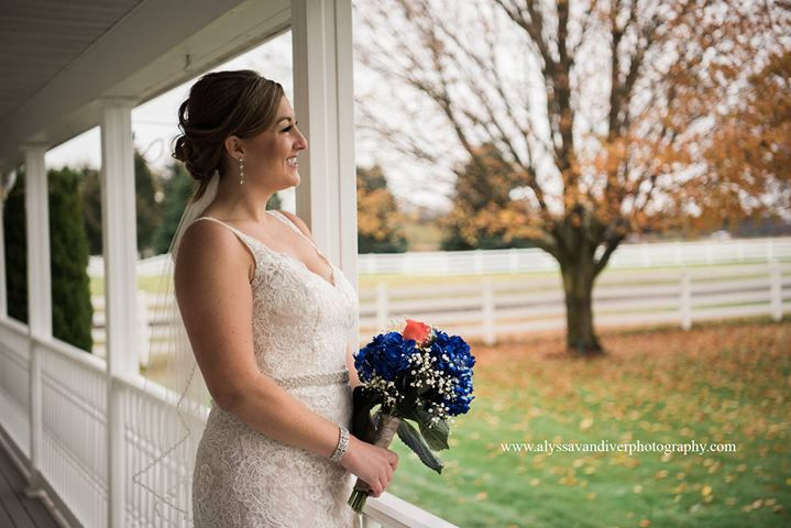 Bride looking out with her bouquet | @AlyssaVandiverPhotography