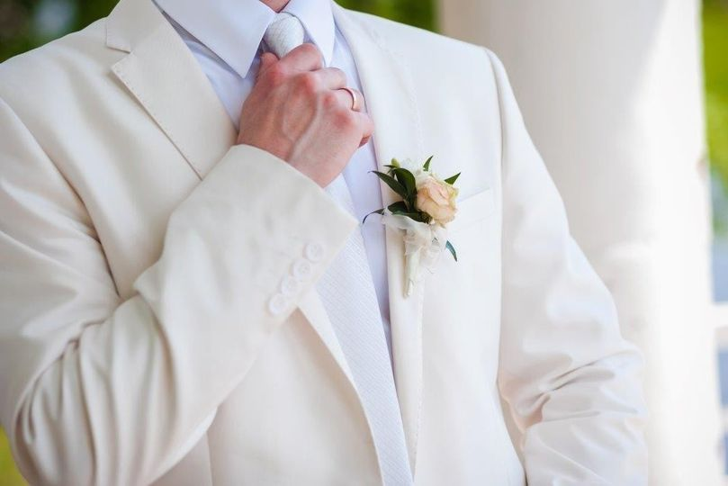 Groom's cream suit and white shirt