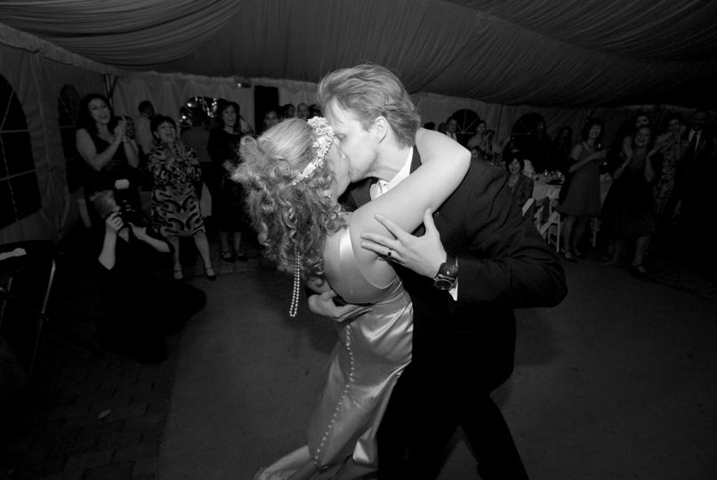 Beautiful couple enjoying a kiss at their wedding reception in the Washington, DC area.