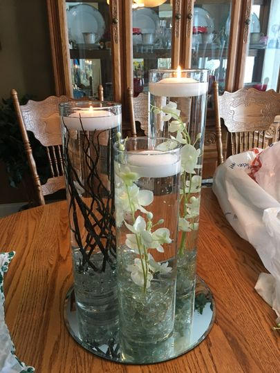 "The ""Shaelyn"" : 3 glass vases (13"", 15"", 17"") filled with water, clear stones on bottom, floating..."
