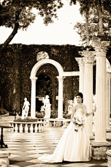 Bride by the columns