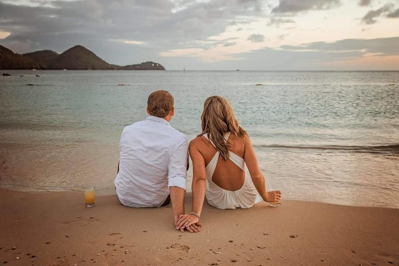 Bride and groom sitting at the beach