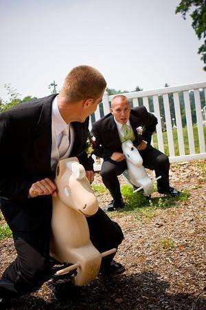 Groom and groomsman playing