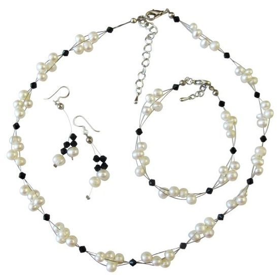 This gorgeous drop down Sparkling Genuine Ab Swarovski Crystals Bicon Round and Long Bicone Beads...