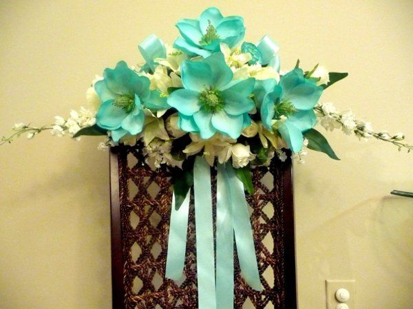 Arbor Decor spray close up.   The arbor is finished off with white tulle and twisting garland and...