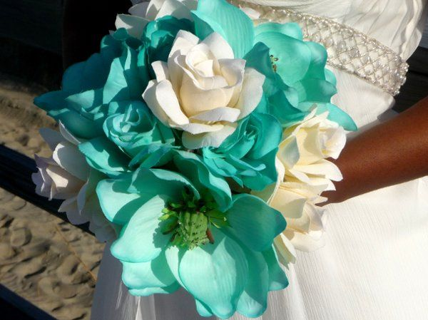 What a lovely picture of the Bride holding one of our Custom made Bouquets. This is a combination of...