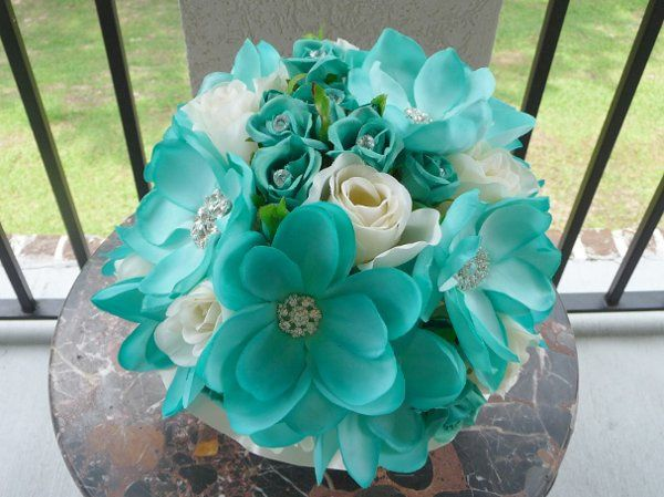 This is a soft teal Magnolia, hand painted with teal Rosebuds and Cream Roses.  We added a bit of...