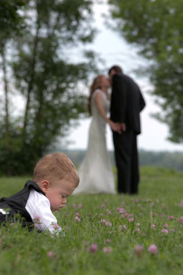This little ring bearer just happened into this photo, completely fascinated with the grasses and...