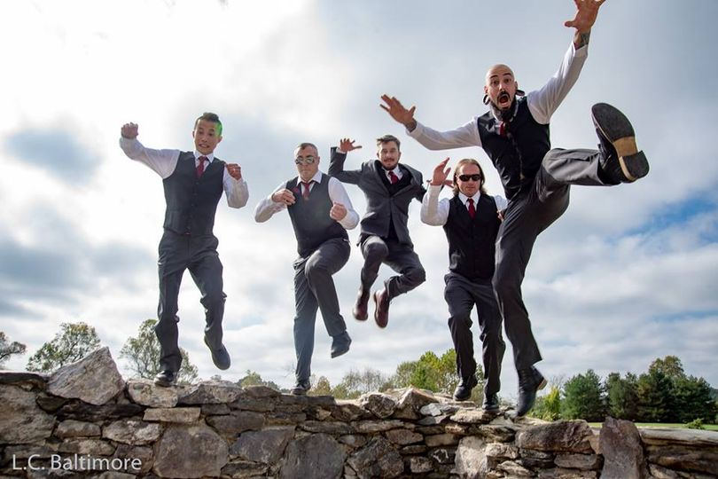 Jump shot of the groom and groomsmen