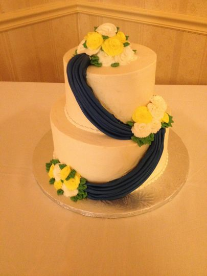 blue and yellow swag cake