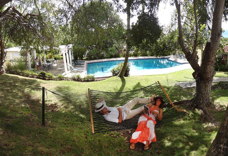 Giant mahogany trees hold cozy hammocks for two.
