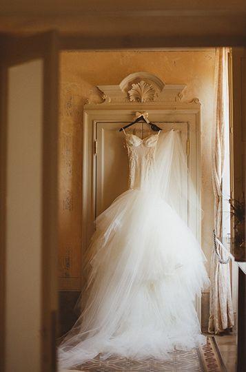 wedding dress hanging in italian villa by my lake
