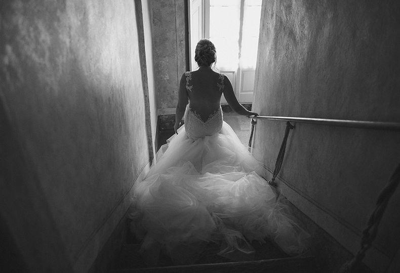 bride in wedding dress on stairs in italian villa