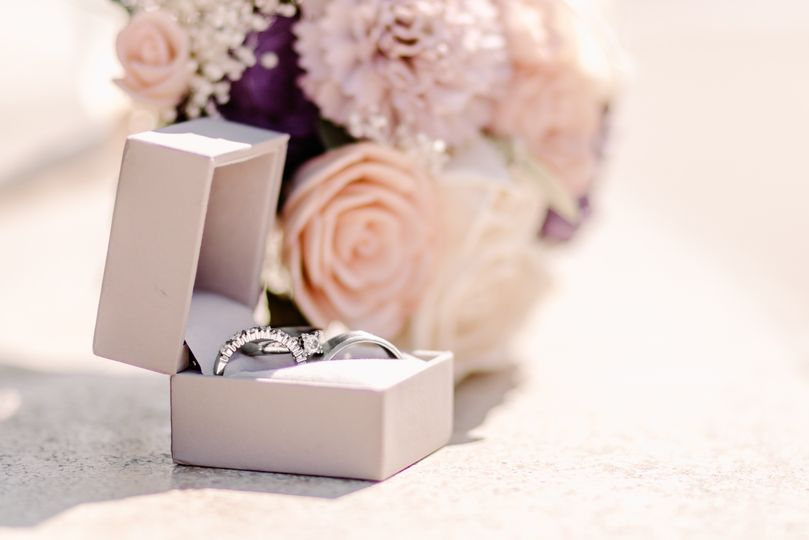 Rings next to flowers