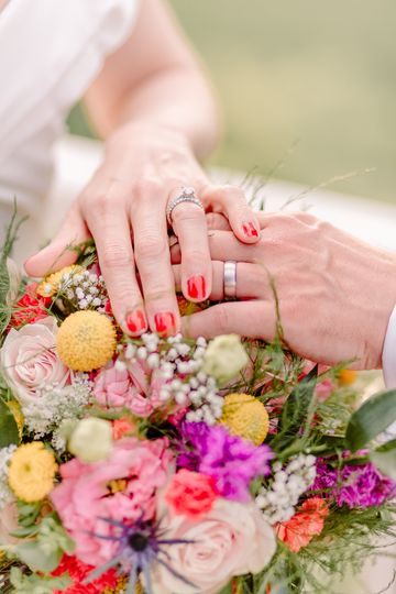 Couples hands over flowers