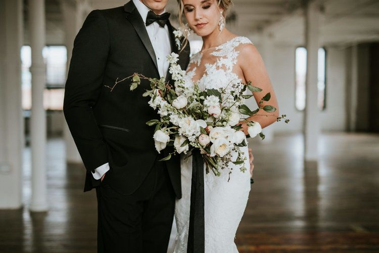 Newlyweds and bridal bouquet