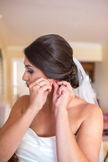 Bride wearing her earing