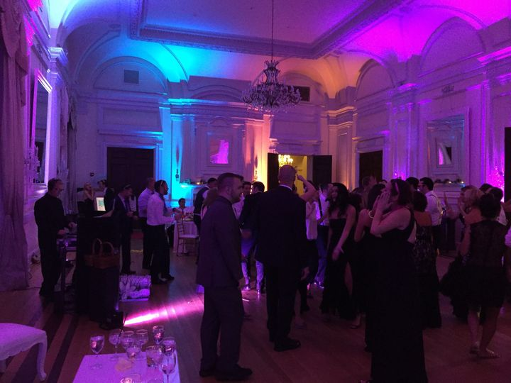 Dj gaige performing a wedding at oheka castle on long island with some uplighting