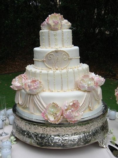 This is a very elegant 4 tiered round cake enhanced with sugar pearl accents, monogram and draping....