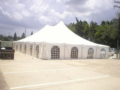 white tent with window sidewalls, suitable for parking reception. window exterior view.